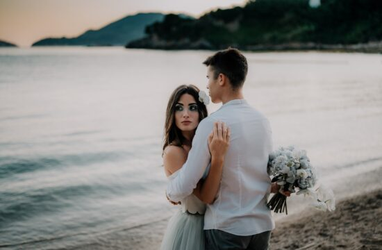 Bride and groom staying close during their secret beach elopement in italy at sunset | Beach Wedding at Cinque Terre