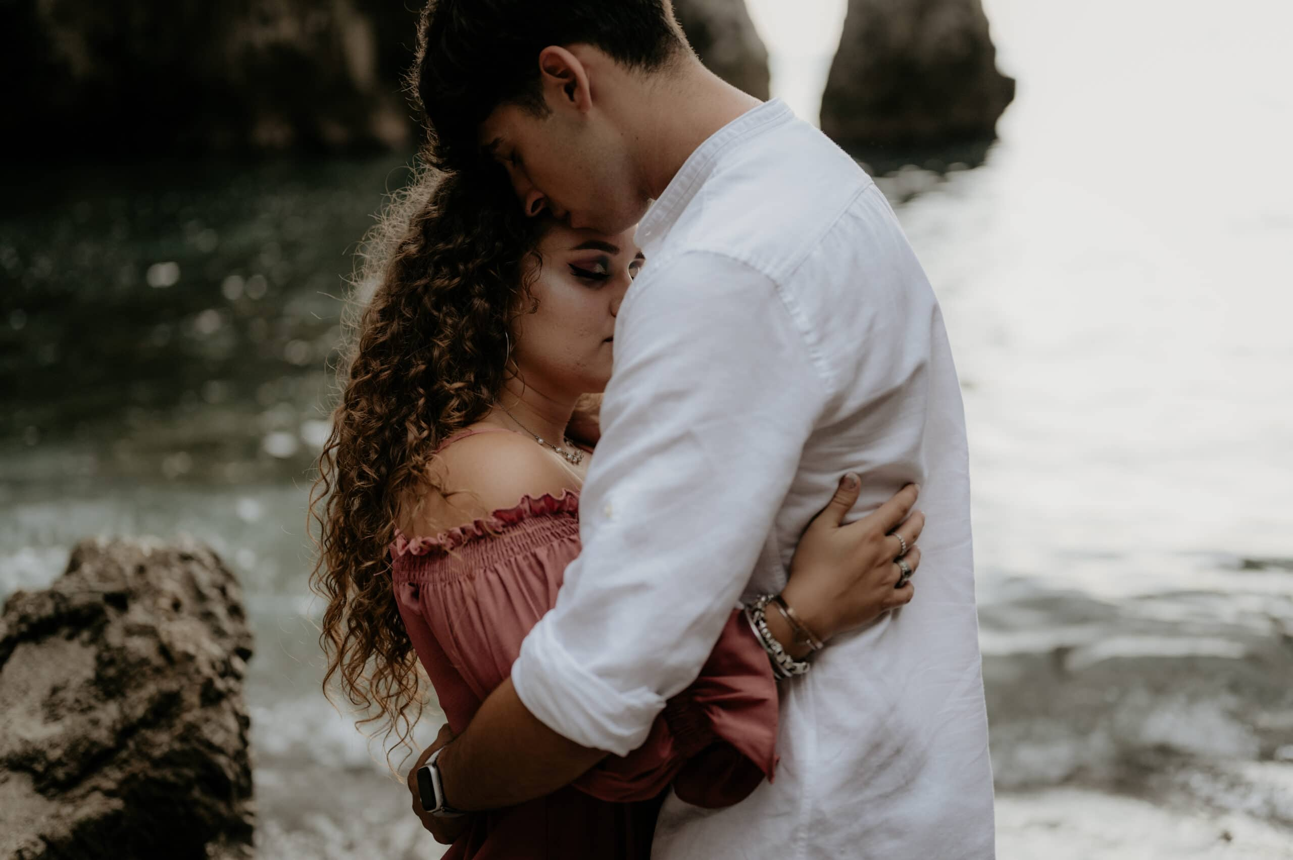 Italy Elopement Package: Couple hugging near sea during their prewedding photoshoot