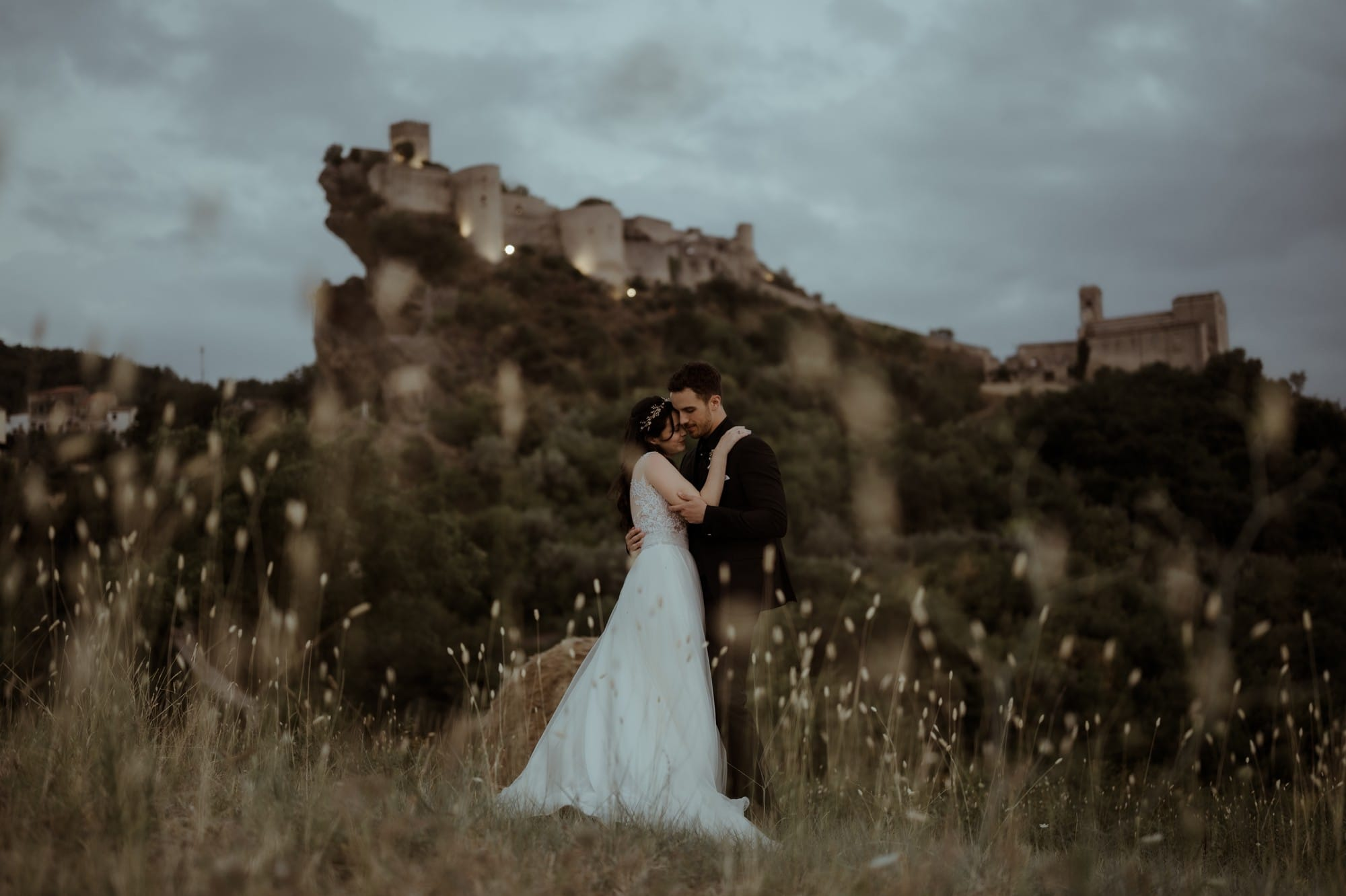 Couple eloping in field at Roccascalegna Castle