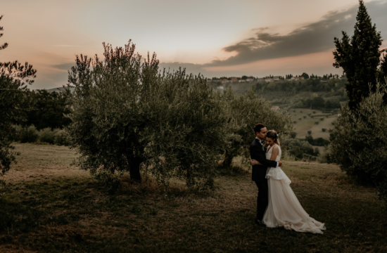 Bride and groom hugging during sunset at a tuscany wedding in Italy