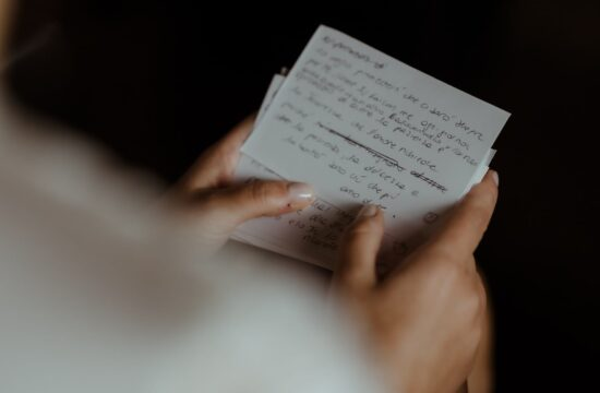 Bride writing her intimate wedding vows for his husband at Lake Como Wedding