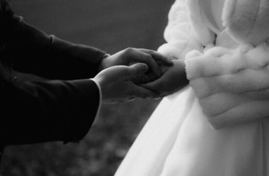 Groom holding bride's hands during wedding in stuttgart