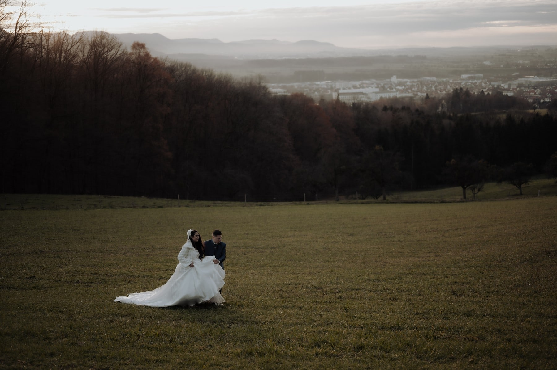 Bride and groom walking in fields during and Intimate Stuttgart Wedding