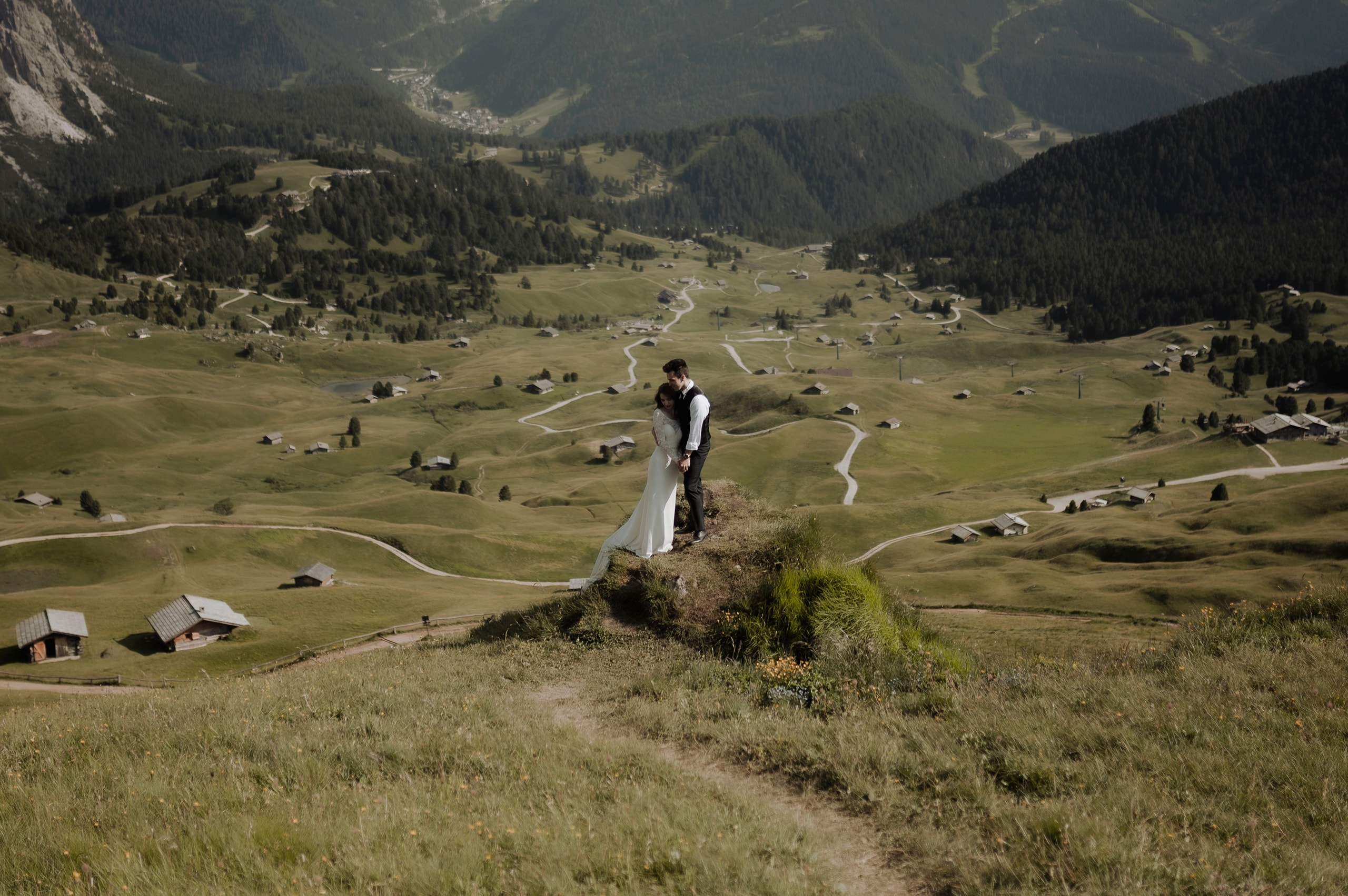 Groom hugging bride at Seceda Dolomites Elopement in Italy